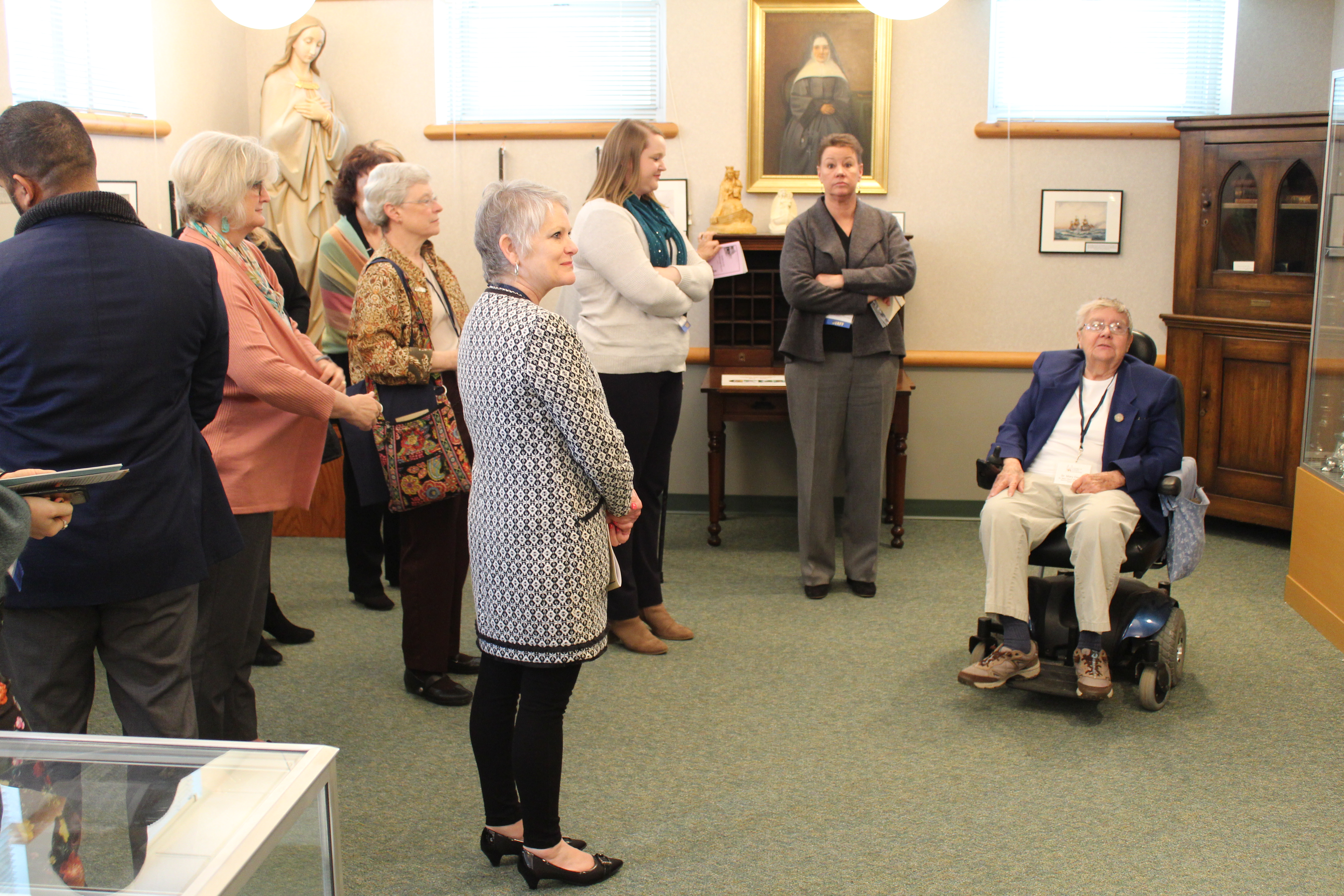Sister Mary Denis Maher, CSA, shows attendees around the Heritage Room at Mt. Augustine